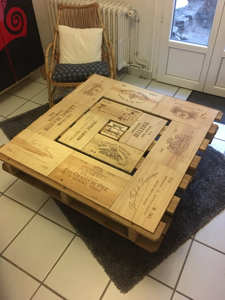 It's a low table that I made with a floor pallet board and cases of wine. What do you think fellow 9gagers?