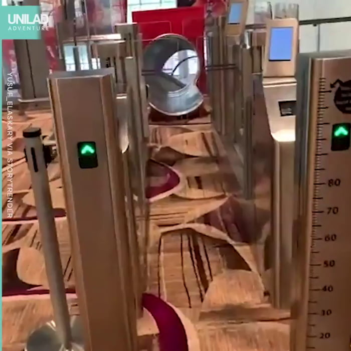 Airport in Singapore has a slide that will take you into the terminal