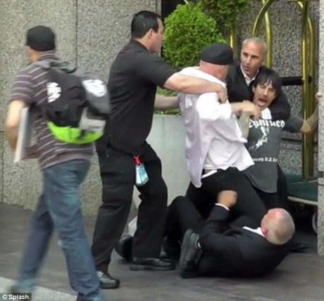 Body guards attack the lead singer for Red Hot Chili Peppers after mistakenly believing that he's a fan.