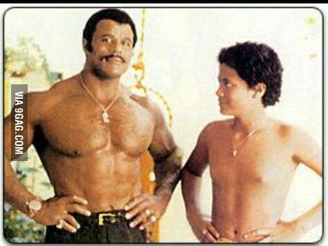 Just a young Dwayne Johnson with his daddy.