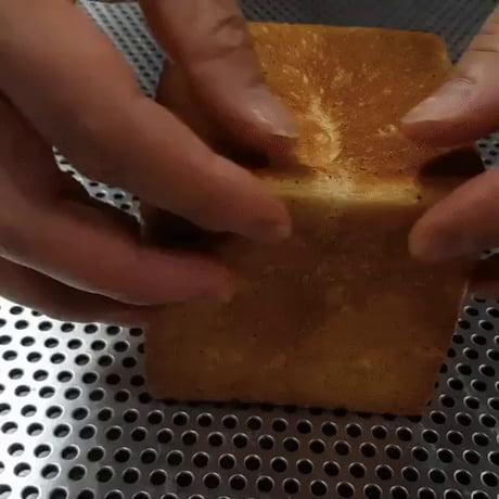 Pulling apart bread
