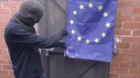 Man tries to burn EU flag but it won't burn because it meets EU regulations on flammable materials