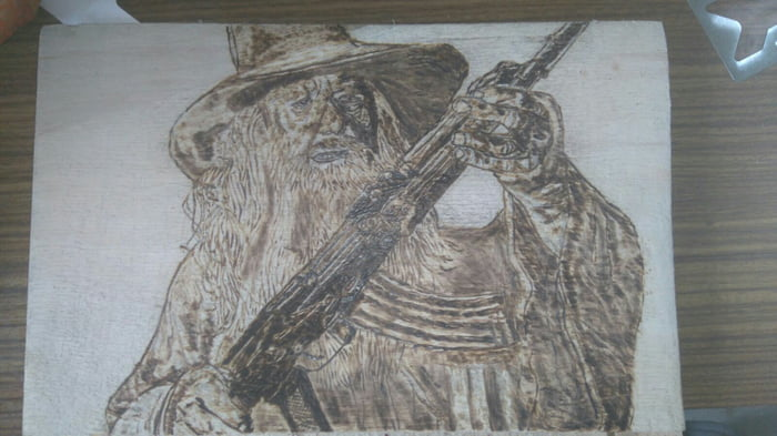 A Woodburned Gandalf With An Ak 47 Post Your Next Requests In