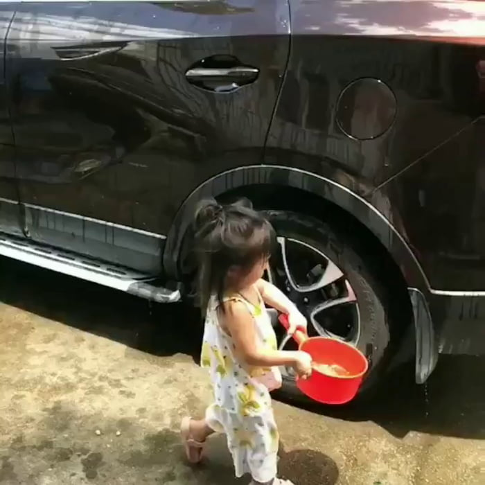 Helping her dad clean the car