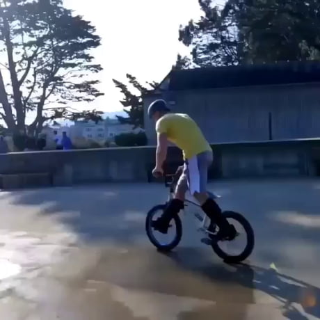 Can someone tell him how to bike in a proper way?