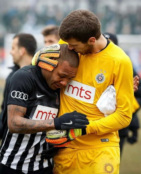 Partizan Belgrade(Serbia) goalkeeper comforts his teammate after he is barraged by racist chants for 90 minutes