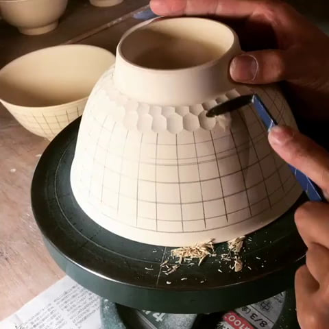 This pottery carving by Abe Haruya.