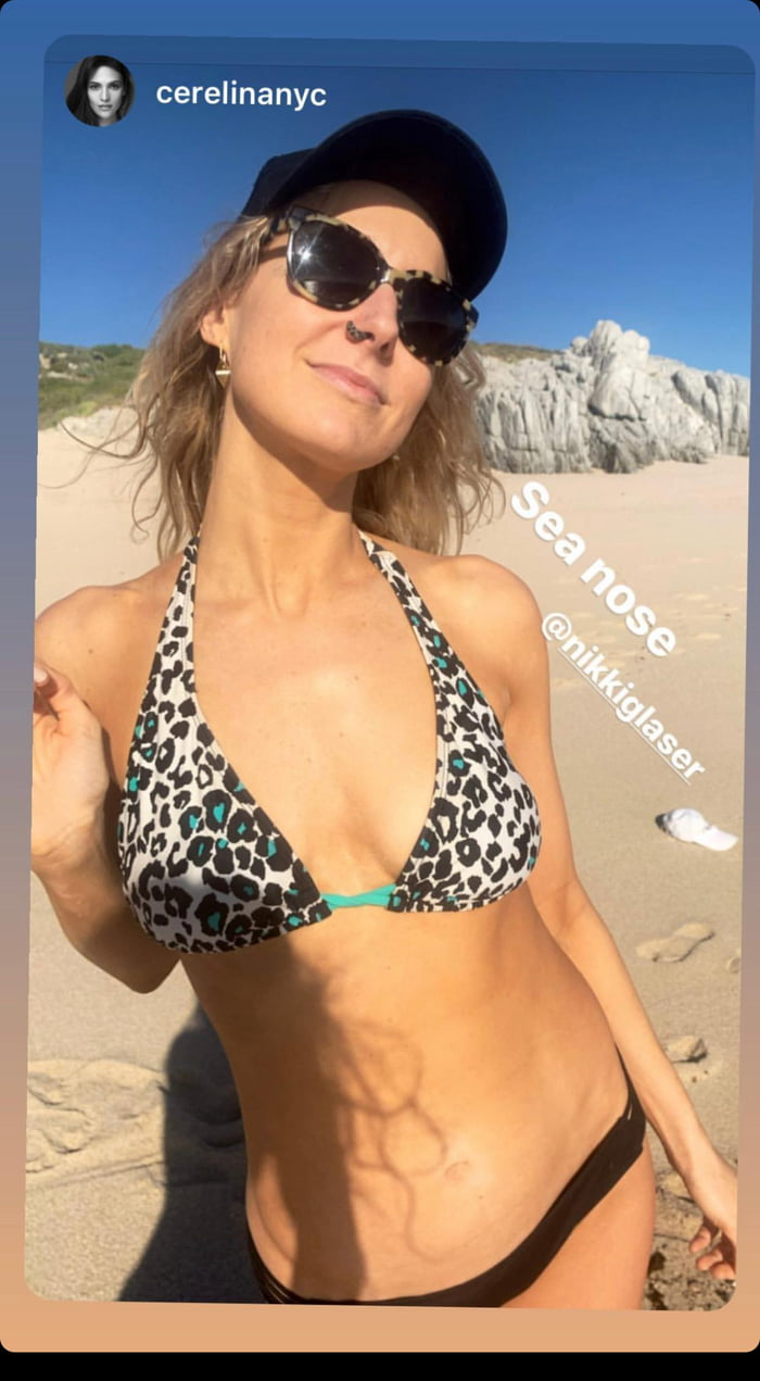 With her slim body and Light blond hairtype without bra (cup size ) on the beach in bikini