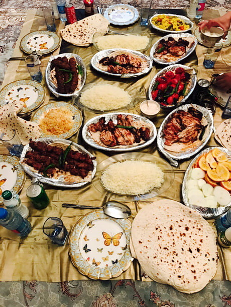 "In IRAN we don't use tables for dinner or lunch, we eat on ground like this! We call it ""sofre"". Ps: it's not too common now."