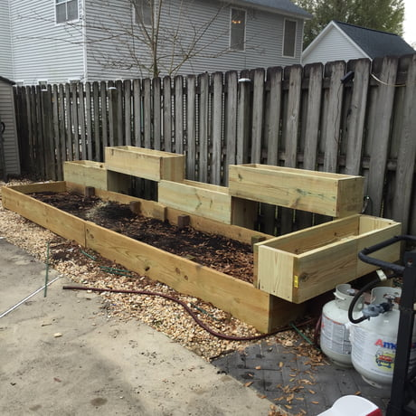 My first ever build, it's a garden with separate sections for herbs. *It's something*