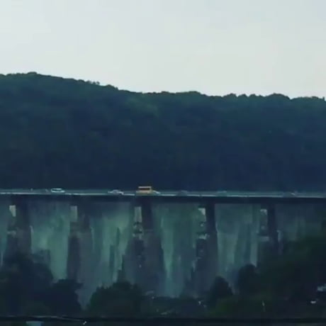Heavy rain water pouring down from a bridge in Ukraine.