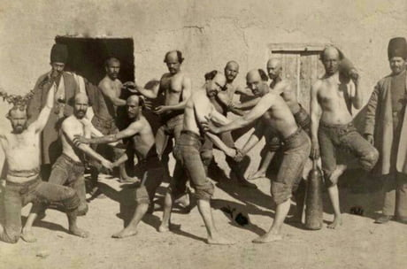 An old Iranian gang. The leader made all the members shave their heads in this fashin because he was bald himself.