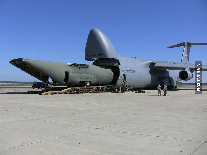 Cargo plane loads a cargo plane - 9GAG