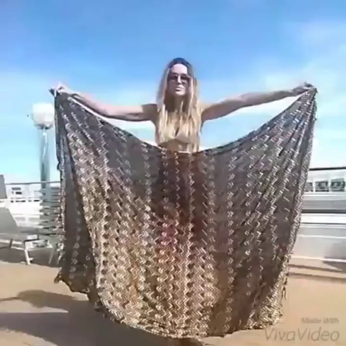 Can make any outfit from a single scarf... she's hot too