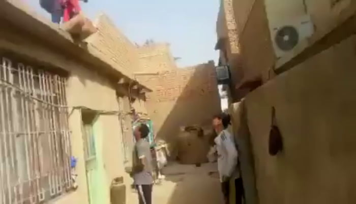 Catching a sack of cement from a roof