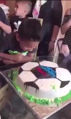 Kid Gets His Face Dunked Into Birthday Cake
