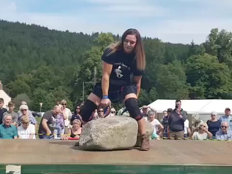 Leigh Holland-Keen lifting the legendary 733-pound Dinnie Stones, second woman ever to do so