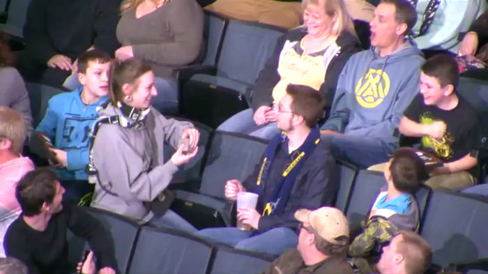 Girl proposes to boy during Kiss Cam