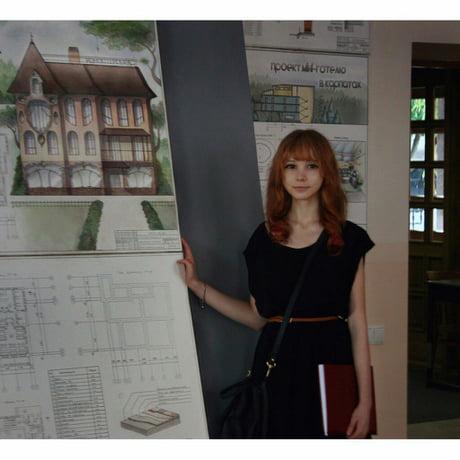 Mirukawa, standing next to her design