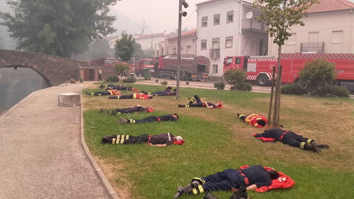 A photo of some portuguese firefighters after several hours of fighting. (taken by Pedro Brás)